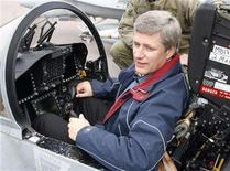 <p>Prime Minister Stephen Harper sits in the cockpit of a CF-18 Canadian Armed Forces fighter jet during his Canadian Western Arctic tour in Inuvik, Northwest Territories, August 28, 2008. REUTERS/Todd Korol</p>