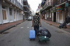 <p>A man hauls bags down Bourbon Street in the French Quarter of New Orleans, Louisiana, ahead of Hurricane Gustav's arrival, August 31, 2008. Hurricane Gustav churned toward the Louisiana coast through the oil-rich Gulf of Mexico on Sunday with strength that could rival 2005's Hurricane Katrina, prompting low-lying New Orleans to begin evacuation. REUTERS/Lee Celano</p>