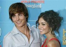 "<p>Zac Efron (L) and Vanessa Hudgens, stars of the Disney Channel movie ""High School Musical 2"" pose at the film's premiere at Downtown Disney in Anaheim, California August 14, 2007. REUTERS/Fred Prouser</p>"