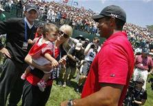 <p>Tiger Woods greets his wife Elin and daughter Sam Alexis after his win in the playoff round of the U.S. Open golf championship at Torrey Pines in San Diego June 16, 2008. REUTERS/Matt Sullivan</p>