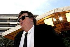 "<p>Michael Moore arrives at the world premiere screening of ""Indiana Jones and the Kingdom of the Crystal Skull"" by U.S. director Steven Spielberg at the 61st Cannes Film Festival May 18, 2008. REUTERS/Jean-Paul Pelissier</p>"