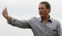 """<p>Actor Jean-Claude Van Damme gestures at a photocall on the beach front during the 61st Cannes Film Festival in this May 17, 2008 file photo. Van Damme's latest film """"JCVD"""" is featured as part of the Toronto Film Festivals' """"Midnight Madness"""" program,which in the past has featured hits such as """"Saw"""" and """"Borat: Cultural Learnings of America for Make Benefit Glorious Nation of Kazakhstan."""" REUTERS/Christian Hartmann/Files</p>"""