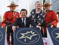 <p>Canadian actor Michael J. Fox (2nd L) poses with his star, along with his mother Phyllis Fox, during Canada's Walk of Fame induction ceremonies in Toronto September 6, 2008. REUTERS/Mark Blinch</p>