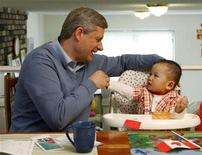 <p>Conservative leader and Canada's Prime Minister Stephen Harper plays with 14-month-old Eric Huang during a campaign stop at the Huang family home in Richmond, British Columbia September 8, 2008. REUTERS/Chris Wattie</p>