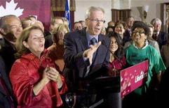 <p>Liberal leader Stephane Dion (C) address supporters with his wife Janine Krieber (L) and daughter Jenne (2nd R) during a rally in his Montreal, Quebec riding September 8, 2008. REUTERS/Andy Clark</p>