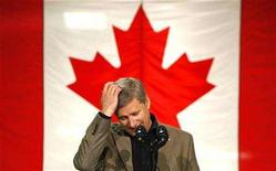 <p>Conservative leader and Canada's Prime Minister Stephen Harper reacts to a question during a campaign stop at a vegetable processing plant in Winnipeg, Manitoba September 9, 2008. Canadians will head to the polls in a federal election October 14. REUTERS/Chris Wattie</p>