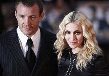 "<p>Director Guy Ritchie and wife Madonna arrive for the world premiere of ""RocknRolla"" at the Odeon cinema in Leicester Square, London September 1, 2008. REUTERS/Stephen Hird</p>"