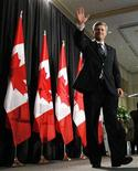 <p>Conservative leader and Prime Minister Stephen Harper waves after delivering a speech to the Indo Chamber of Commerce in Vaughan, Ontario September 10, 2008. REUTERS/Chris Wattie</p>