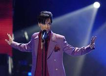 "<p>Prince performs in a surprise appearance on the ""American Idol"" television show finale at the Kodak Theater in Hollywood, May 24, 2006. REUTERS/Chris Pizzello</p>"