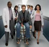 "<p>Hugh Laurie (C) and the cast of ""House"" in an undated photo courtesy of Fox Broadcasting. REUTERS/Handout</p>"