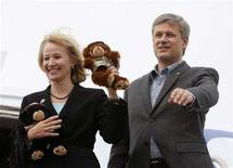 <p>Conservative leader and Canada's Prime Minister Stephen Harper waves as he boards his campaign plane with his wife Laureen in Halifax, Nova Scotia September 12, 2008. REUTERS/Chris Wattie</p>