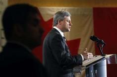 <p>Conservative leader and Canada's Prime Minister Stephen Harper is flanked by security while delivering a speech to the Halifax Chamber of Commerce in Halifax, Nova Scotia September 12, 2008. REUTERS/Chris Wattie</p>