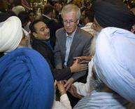 <p>Liberal Leader Stephane Dion is greeted by supporters during an election rally in Surrey, British Columbia September 12, 2008. REUTERS/Andy Clark</p>