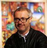 <p>Британский художник Дэмиен Херст ждет церемонии награждения в акционном доме Christie's в Лондоне 1 сентября 2006 года. Аукцион картин Дэмиена Херста, на котором были выставлены 54 произведения, принес в понедельник рекордные 70,55 миллиона фунтов стерлингов ($127 миллионов), тем самым доказав устойчивость рынка произведений искусства к экономическим факторам. REUTERS/Luke MacGregor</p>