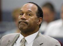 <p>Defendant O.J. Simpson appears in court for the opening day of his trial on September 15, 2008 in Las Vegas, Nevada. Simpson is charged with a total of twelve counts including kidnapping, armed robbery and assault with a deadly weapon stemming from an alleged incident involving the theft of his sports memorabilia. REUTERS/Jae C. Hong/Pool</p>