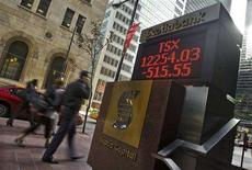 <p>People walk by a sign displaying TSX information in Toronto, September 15, 2008. REUTERS/Mark Blinch</p>