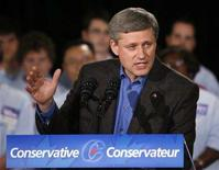 <p>Canada's Prime Minister Stephen Harper delivers his speech during a campaign rally at St. Volodymyr Cultural Centre in Oakville September 16, 2008. REUTERS/Mike Cassese</p>