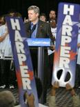 <p>Canada's Prime Minister Stephen Harper delivers his speech during a campaign rally at St. Volodymyr Cultural Centre in Oakville, September 16, 2008. REUTERS/ Mike Cassese</p>