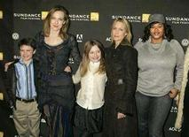 "<p>The director and cast of the film ""Hounddog"" pose as they arrive for the film's premiere at the 2007 Sundance Film Festival in Park City, Utah January 22, 2007. REUTERS/Fred Prouser</p>"