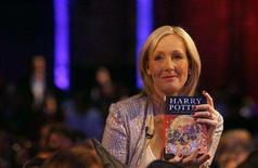 "<p>Author J.K. Rowling poses with a copy of her book ""Harry Potter and the Deathly Hallows"" at the Natural History Museum in London July 20, 2007. REUTERS/Alessia Pierdomenico</p>"