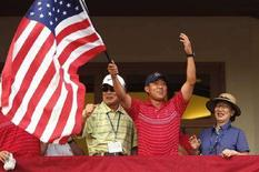 <p>Anthony Kim festeggia la vittoria. REUTERS/Eddie Keogh (UNITED STATES)</p>