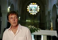 <p>Former Beatles star Paul McCartney visits the Nativity Church in Bethlehem September 24, 2008. REUTERS/Ammar Awad</p>