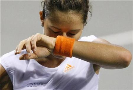 Serbia's Ana Ivanovic reacts after losing points against Russia's Nadia Petrova during their match at the Pan Pacific Open tennis tournament in Tokyo September 18, 2008. REUTERS/Issei Kato