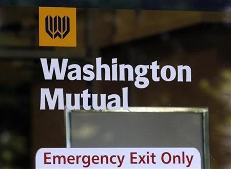 A signage is seen on a door at a Washington Mutual (WaMu) bank branch office in Glendale, California September 18, 2008. REUTERS/Fred Prouser