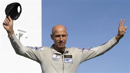 Swiss airline pilot Yves Rossy gestures after becoming the first person to cross the English channel with a jetpack strapped to his back, in Dover southern England September 26, 2008. REUTERS/Kieran Doherty