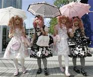 "<p>Japanese women dressed in Lolita fashion walk in front of the venue of the ""Individual Fashion Expo.IV"", a gothic, Lolita and punk fashion event, in Tokyo September 23, 2008. REUTERS/Yuriko Nakao</p>"