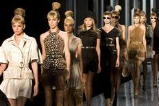 <p>Models appear on the catwalk at the end of French fashion house Dior Spring/Summer 2009 women's ready-to-wear fashion show by British designer John Galliano in Paris September 29, 2008. REUTERS/Charles Platiau</p>