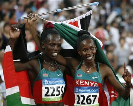 Pamela Jelimo of Kenya celebrates winning the gold medal with silver medallist Janeth Jepkosgei Busienei of Kenya after competing in the women's 800m final of the athletics competition in the National Stadium at the Beijing 2008 Olympic Games in this August 18, 2008 file photo. REUTERS/Mike Blake/Files