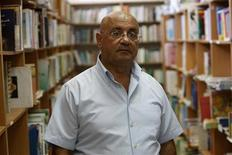 <p>Israeli Saleh Abbasi poses in his publishing house in the northern Israeli city of Haifa August 18, 2008. Abbasi says he wants to use his publishing business to foster cultural ties between Israel and its Arab neighbours, but his plan was dealt a setback by a ban on importing books from Lebanon and Syria. Israel has no diplomatic ties with Beirut and Damascus, so Abbasi, an Arab citizen of the Jewish state, has been using Jordan and Egypt as conduits to trade books with publishers in Lebanon and Syria. Picture taken August 18, 2008. To match feature ISRAEL-BOOKS/BAN REUTERS/Baz Ratner</p>
