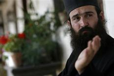 <p>Bulgarian monk Brother Nikanor, 32, speaks to Reuters at Tsurnogorski monastery, some 50 km (31miles) west of the capital Sofia, September 24, 2008. The Nasdaq broker turned monk advises his former colleagues, shattered by the financial crisis, to keep a jar full of soil on their desks to remind them about where we are all heading to and what really matters in life. Five years ago, after failing to find happiness in the life he lived, the Christian Orthodox who hadn't practised as a child quit the New York-based market for a dilapidated Bulgarian monastery that once served as a communist labour camp. Picture taken September 24, 2008. To match feature FINANCIAL/MONK REUTERS/Stoyan Nenov</p>