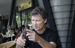 <p>German musician Michael Rother gives a Reuters interview in Berlin in this August 21, 2008 file photo. REUTERS/Tobias Schwarz/Files</p>