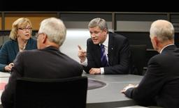 <p>Prime Minister Stephen Harper (C) gestures while taking part in the French leaders' debate with Green Party leader Elizabeth May (L), Liberal Party leader Stephane Dion and New Democratic Party leader Jack Layton (R) in Ottawa, October 1, 2008. REUTERS/Tom Hanson/Pool</p>