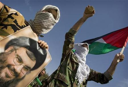 Demonstrators wearing Palestinian scarves hold the national flag and a portrait of the Lebanon's Hezbollah leader Sayyed Hassan Nasrallah during Jerusalem Day demonstrations in Tehran September 26, 2008. REUTERS/Morteza Nikoubazl