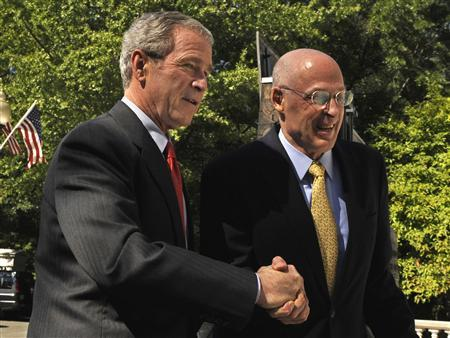 President George W. Bush (L) shakes hands with Treasury Secretary Henry Paulson as he walks from the White House to the Treasury Building, after the House passed the $700 billion financial rescue legislation in Washington, October 3, 2008. REUTERS/Mike Theiler