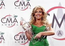 <p>Lee Ann Womack displays her three awards in the press room the 39th Annual Country Music Awards, in New York, November 15, 2005. REUTERS/ Mario Anzuoni</p>