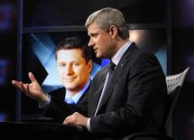 <p>Conservative leader and Canada's Prime Minister Stephen Harper speaks during a television interview in Toronto October 7, 2008. REUTERS/Chris Wattie</p>