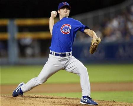 Chicago Cubs starting pitcher Rich Harden faces the Los Angeles Dodgers in the first inning during Game 3 of their MLB National League Divisional Series playoff baseball game in Los Angeles, October 4, 2008. REUTERS/Danny Moloshok