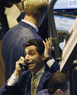 A trader works on the telephone on the floor of the New York Stock Exchange in the final minutes of the trading session in New York, October 9, 2008. REUTERS/Mike Segar