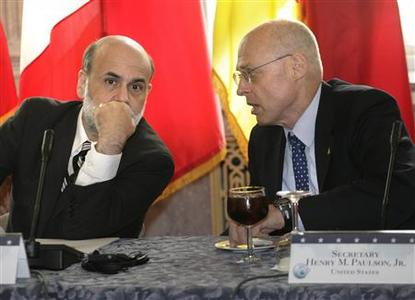 U.S. Treasury Secretary Henry Paulson (R) talks to Federal Reserve Chairman Ben Bernanke at the beginning of the G7 Ministerial meeting at the Treasury Department in Washington October 10, 2008. REUTERS/Yuri Gripas