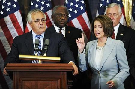 Rep. Barney Frank and House Speaker Nancy Pelosi address the passage of the $700 billion financial bailout bill to provide relief for the current financial and banking crisis, at the US Capitol in Washington, October 3, 2008. REUTERS/Jonathan Ernst