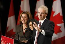<p>Liberal leader Stephane Dion speaks to supporters at his election night headquarters with his wife Jannine Krieber and daughter Jeanne at his side in Montreal, October 14, 2008. REUTERS/Christinne Muschi</p>