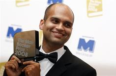 "<p>Indian author Aravind Adiga poses for photographers after winning the 2008 Man Booker Prize with his book ""The White Tiger"" at the Guildhall in London October 14, 2008. REUTERS/Alessia Pierdomenico</p>"