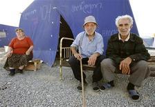 <p>Грузинские беженцы во временном лагере в Гори 16 сентября 2008 года.Около 20.000 грузинских беженцев вернулись в свои дома в буферных зонах между Южной Осетией и остальной частью Грузии после того, как Россия вывела оттуда свои войска, сообщило агентство ООН по делам беженцев во вторник. REUTERS/David Mdzinarishvili</p>