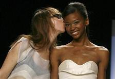 <p>Designer Leanne Marshall kisses one of her models during the taping of the season finale of Project Runway during New York Fashion Week September 12, 2008. REUTERS/Keith Bedford</p>