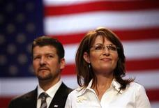 <p>Republican vice presidential nominee Alaska Governor Sarah Palin and her husband Todd attend a rally in Virginia Beach, Virginia October 13, 2008. REUTERS/Carlos Barria</p>