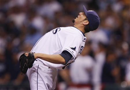 Tampa Bay Rays pitcher Matt Garza stretches before the start of Game 7 of their MLB ALCS playoff series game against the Boston Red Sox in St. Petersburg, Florida, October 19, 2008. REUTERS/Hans Deryk